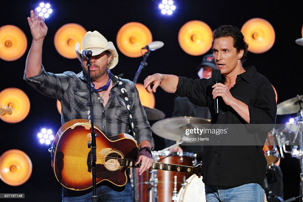 <a gi-track='captionPersonalityLinkClicked' href=/galleries/search?phrase=Toby+Keith&family=editorial&specificpeople=204525 ng-click='$event.stopPropagation()'>Toby Keith</a> and <a gi-track='captionPersonalityLinkClicked' href=/galleries/search?phrase=Matthew+McConaughey&family=editorial&specificpeople=201663 ng-click='$event.stopPropagation()'>Matthew McConaughey</a> on stage at the 2016 American Country Countdown Awards at The Forum on May 1, 2016 in Inglewood, California.
