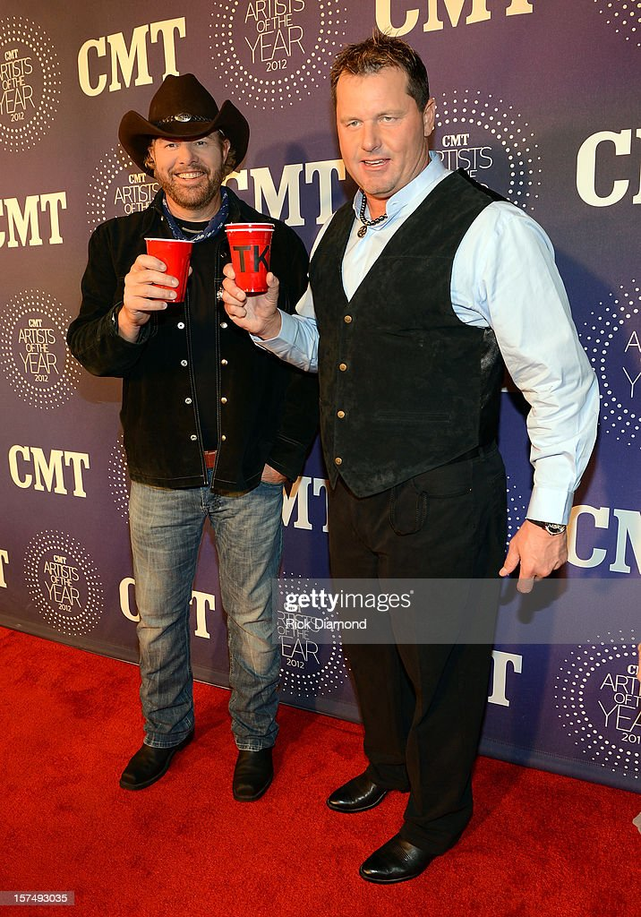 <a gi-track='captionPersonalityLinkClicked' href=/galleries/search?phrase=Toby+Keith&family=editorial&specificpeople=204525 ng-click='$event.stopPropagation()'>Toby Keith</a> and <a gi-track='captionPersonalityLinkClicked' href=/galleries/search?phrase=Roger+Clemens&family=editorial&specificpeople=171089 ng-click='$event.stopPropagation()'>Roger Clemens</a> attend 2012 CMT Artists Of The Year at The Factory at Franklin on December 3, 2012 in Franklin, Tennessee.