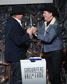 Toby Keith and Stephen Colbert speak during the Songwriters Hall Of Fame 46th Annual Induction And Awards at Marriott Marquis Hotel on June 18 2015...