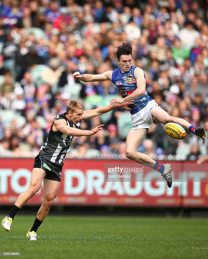 Toby McLean of the Bulldogs and Josh Smith of the Magpies compete for the ball during the round 10 AFL match between the Collingwood Magpies and the Western Bulldogs at Melbourne Cricket Ground on May 29, 2016 in Melbourne, Australia.