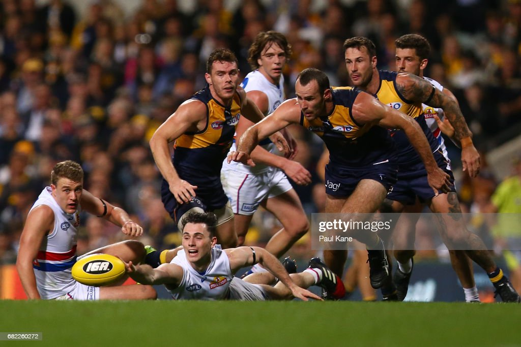 Toby McLean of the Bulldogs dives for the ball during the round eight AFL match between the West Coast Eagles and the Western Bulldogs at Domain Stadium on May 12, 2017 in Perth, Australia.
