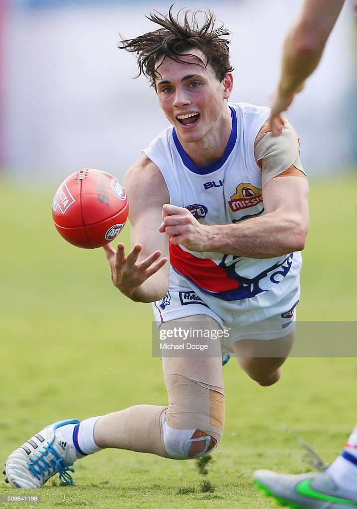 Toby McLean of the Bulldogs handballs during the Western Bulldogs AFL intra-club match at Whitten Oval on February 13, 2016 in Melbourne, Australia.