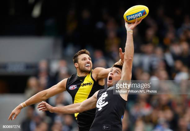 Toby Nankervis of the Tigers and Matthew Kreuzer of the Blues compete in a ruck contest during the 2017 AFL round 14 match between the Richmond...