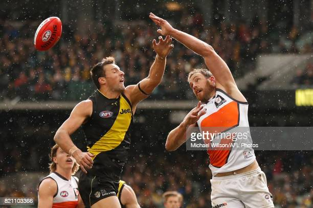 Toby Nankervis of the Tigers and Shane Mumford of the Giants compete in a ruck contest during the 2017 AFL round 18 match between the Richmond Tigers...