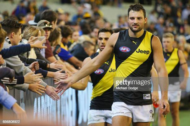 Toby Nankervis of the Tigers celebrates the win with fans during the round one AFL match between the Carlton Blues and the Richmond Tigers at...