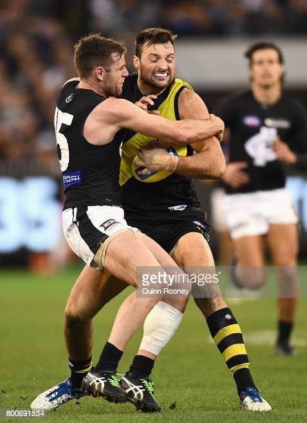 Toby Nankervis of the Tigers is tackled by Sam Docherty of the Blues during the round 14 AFL match between the Richmond Tigers and the Carlton Blues...