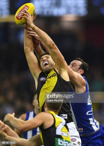 Toby Nankervis of the Tigers marks infront of Todd Goldstein of the Kangaroos during the round 11 AFL match between the North Melbourne Kangaroos and...