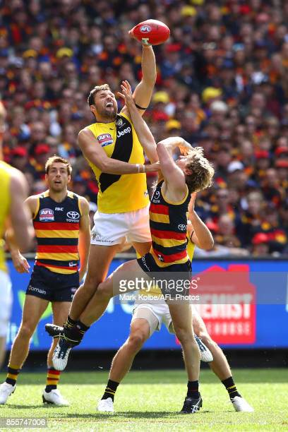 Toby Nankervis of the Tigers punches the ball away from Rory Sloane of the Crows during the 2017 AFL Grand Final match between the Adelaide Crows and...