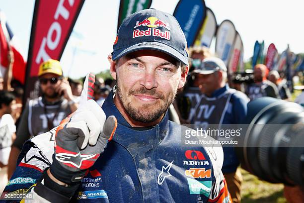 Toby Price of Australia riding on and for KTM 450 RED BULL KTM FACTORY TEAM celebrates winning the overall race as he arrives at the end of stage...