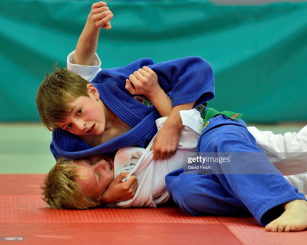 Toby Roberts of Camberley (blue), here watching the clock tick away, held Samuel Morris of 2A's Judokwai with a scarf hold for ippon (10 points) to win their Pre Cadet Boys Under 46kgs contest during the British Cadet and Pre-Cadet Judo Championships on day 2, Sunday, January 13, 2013 at the English Institute of Sport, Sheffield, England, UK.