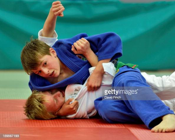 Toby Roberts of Camberley here watching the clock tick away held Samuel Morris of 2A's Judokwai with a scarf hold for ippon to win their Pre Cadet...