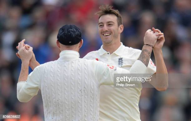 Toby RolandJones of England celebrates after dismissing Hashim Amla of South Africa during the second day of the 4th Investec Test match between...