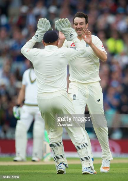 Toby RolandJones of England celebrates taking the wicket of Quinton de Kock of South Africa during day two of the 3rd Investec test between England...