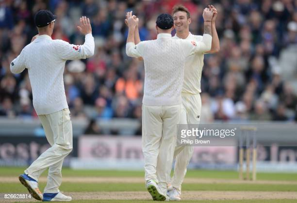 Toby RolandJones of England celebrates with Ben Stokes and Keaton Jennings after dismissing Hashim Amla of South Africa during the second day of the...