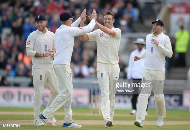 Toby RolandJones of England celebrates with Ben Stokes Keaton Jennings and Dawid Malan after dismissing Hashim Amla of South Africa during the second...