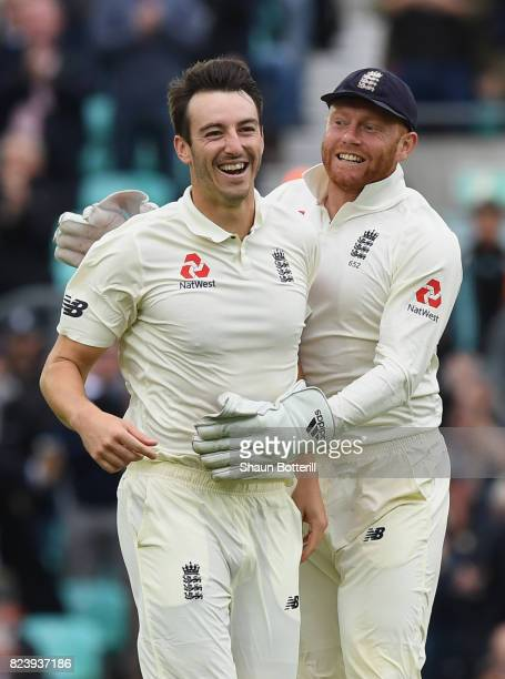 Toby RolandJones of England celebrates with Jonny Bairstowafter taking his fourth wicket during day two of the 3rd Investec Test match between...