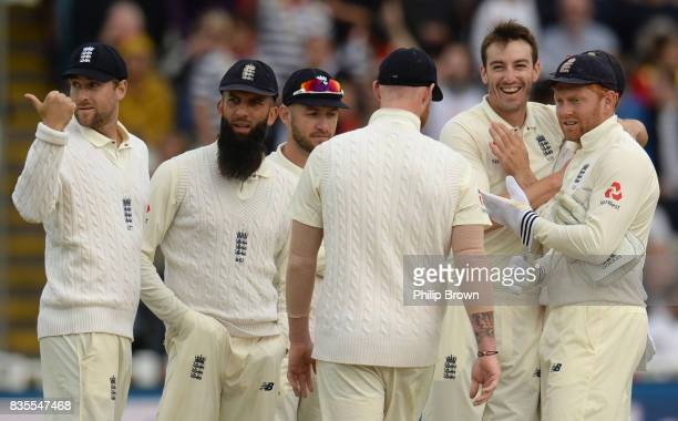Toby RolandJones of England is congratulated after dismissing Kyle Hope during the third day of the 1st Investec Test match between England and the...