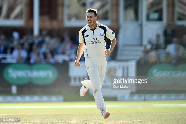 Toby RolandJones of Middlesex celebrates taking the wicket of Adam Lyth of Yorkshire during day four of the Specsavers County Championship match...