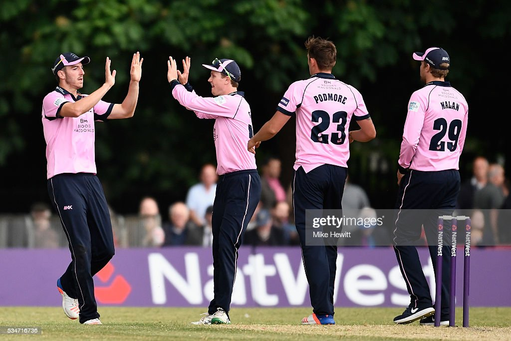Toby Roland-Jones of Middlesex (L) is congratulated by teammates after taking the catch to dismiss Liam Dawson of Hampshire during the NatWest T20 Blast between Middlesex and Hampshire at the Uckfield Sports Ground on May 27, 2016 in Uckfield, England.