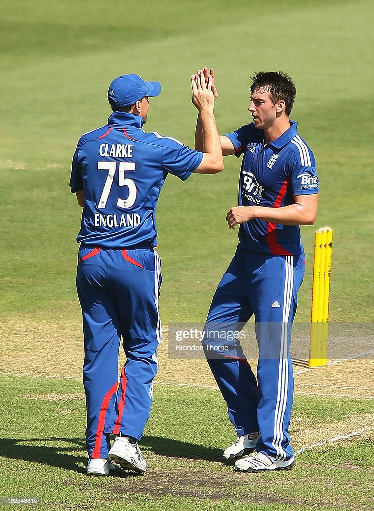 Toby Roland-Jones of the Lions celebrates with team mate Rikki Clarke after claiming the wicket of Callum Ferguson of Australia 'A' during the International Tour match between Australia 'A' and the England Lions at Sydney Cricket Ground on February 25, 2013 in Sydney, Australia.