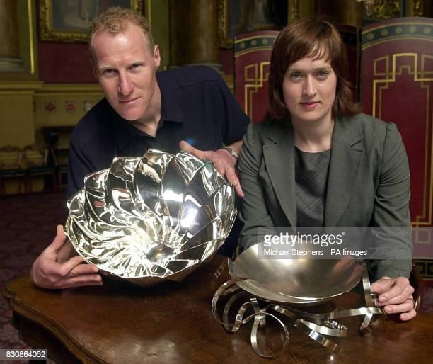 Toby Russell from Twickenham holds his silver bowl made for the Goldsmith's Company with Ane Christensen from Denmark with her Floating Bowl at...