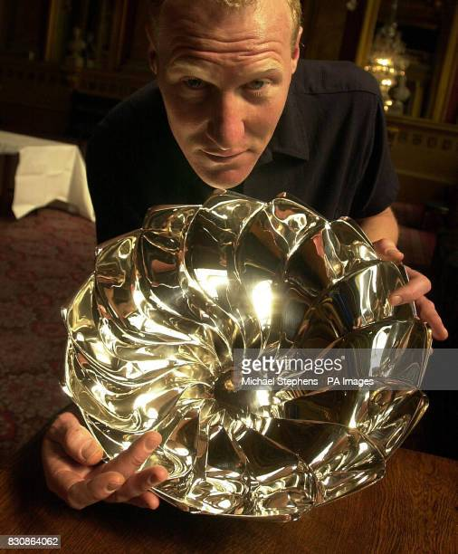 Toby Russell from Twickenham with his silver bowl at Goldsmith's Hall London which is among a number of rare pieces to go on show today to mark the...