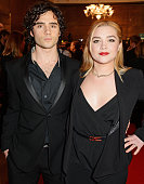 Toby Sebastian and Florence Pugh attend The London Critics' Circle Film Awards at The Mayfair Hotel on January 18 2015 in London England