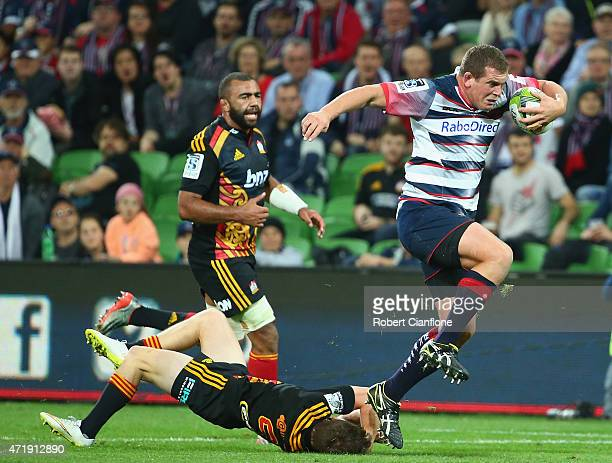 Toby Smith of the Rebels is challenged by Brad Weber of the Chiefs during the round 12 Super Rugby match between the Rebels and the Chiefs at AAMI...