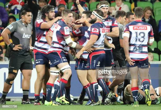 Toby Smith of the Rebels is congratulated by his teammates after scoring a try during the round 14 Super Rugby match between the Rebels and the...