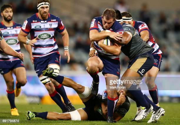 Toby Smith of the Rebels is tackled during the round 15 Super Rugby match between the Brumbies and the Rebels at GIO Stadium on June 3 2017 in...