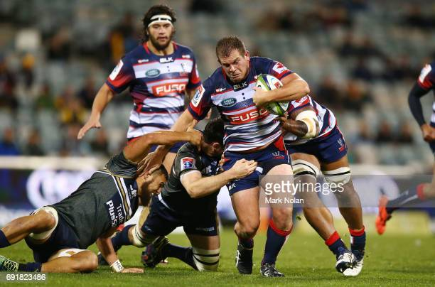 Toby Smith of the Rebels runs the ball during the round 15 Super Rugby match between the Brumbies and the Rebels at GIO Stadium on June 3 2017 in...
