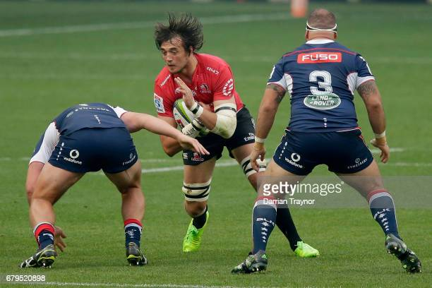 Toby Smith of the Rebels tackles Franco Mostert of the Lions during the round 11 Super Rugby match between the Rebels and the Lions at AAMI Park on...