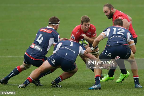 Toby Smith of the Rebels tackles Kwagga Smith of the Lions during the round 11 Super Rugby match between the Rebels and the Lions at AAMI Park on May...