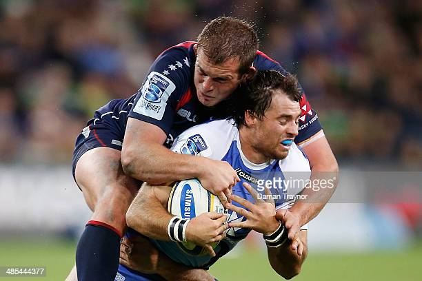 Toby Smith of the Rebels tackles Sias Ebersohn of the Force during the round 10 Super Rugby match between the Melbourne Rebels and the Western Force...