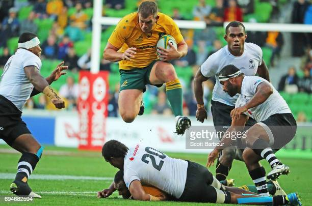 Toby Smith of the Wallabies runs with the ball during the International Test match between the Australian Wallabies and Fiji at AAMI Park on June 10...