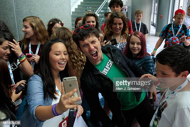 Toby Turner standup comedian actor songwriter and YouTube personality takes photos signs autographs and interacts with fans at VidCon at the Anaheim...