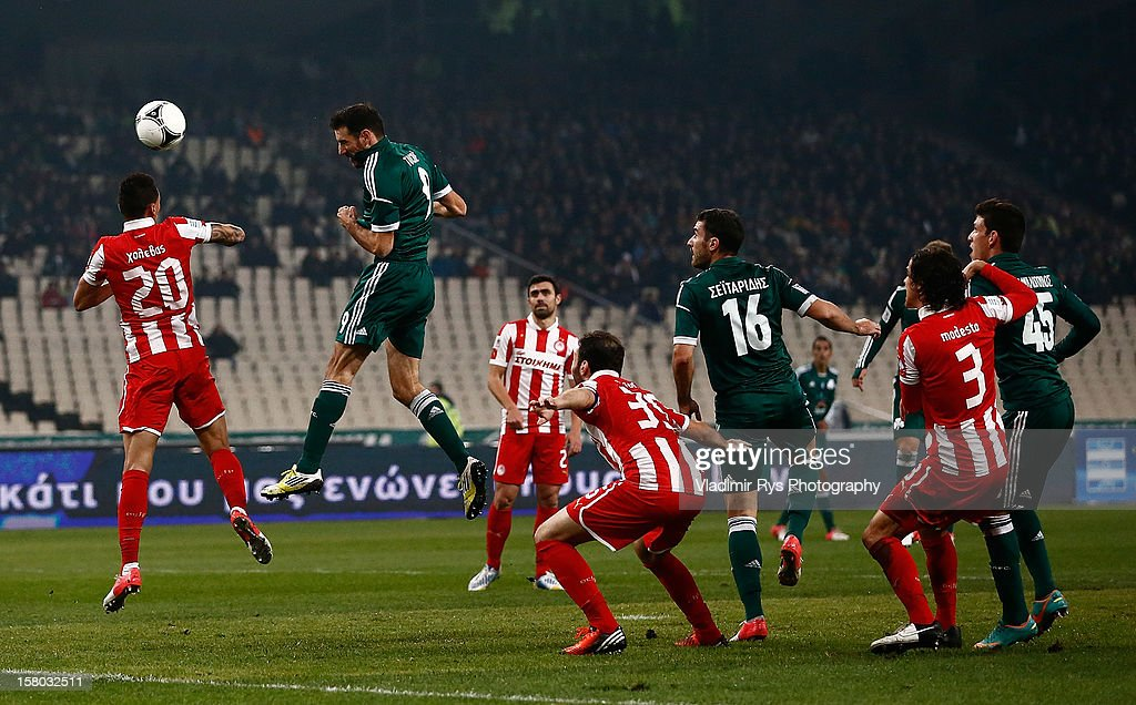 Toche of Panathinaikos and Jose Holevas of Olympiacos (L) vie for a header during the Superleague match between Panathinaikos FC and Olympiacos Piraeus at OAKA Stadium on December 9, 2012 in Athens, Greece.