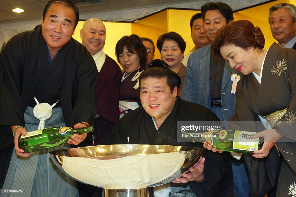Tochiazuma celebrates winning the tournament after day fifteen of the Grand Sumo Kyushu Tournament on November 23 2003 in Fukuoka Japan