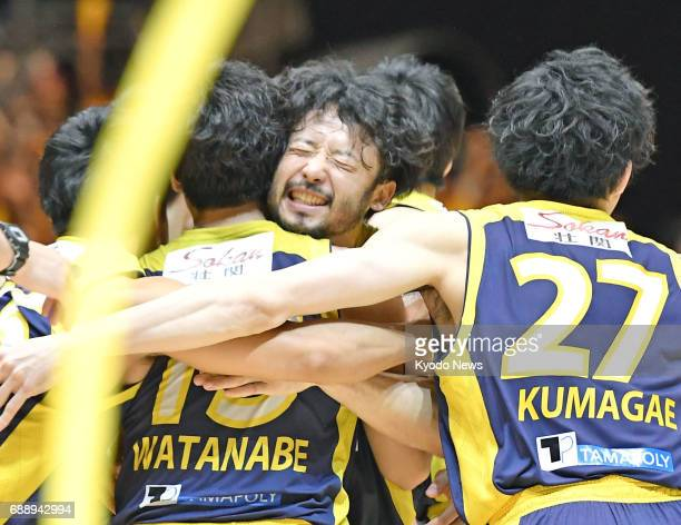 Tochigi Brex point guard Yuta Tabuse celebrates after an 8579 win over the Kawasaki Brave Thunders in the onegame final to capture the inaugural...