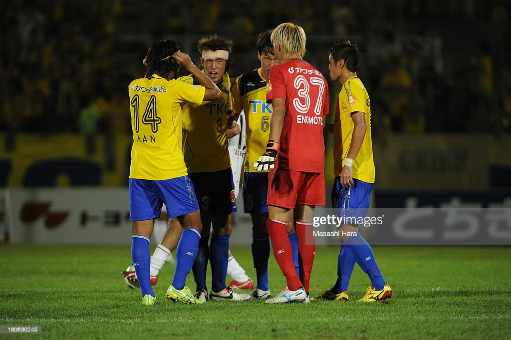 Tochigi SC players make the huddle during the J.League second division match between Tochigi SC and Consadole Sapporo at Tochigi Green Stadium on September 15, 2013 in Utsunomiya, Japan.