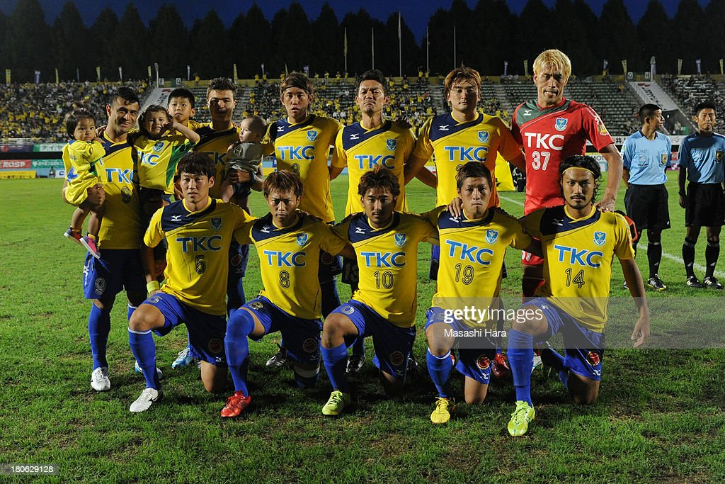 Tochigi SC players pose for photograph prior to the J.League second division match between Tochigi SC and Consadole Sapporo at Tochigi Green Stadium on September 15, 2013 in Utsunomiya, Japan.