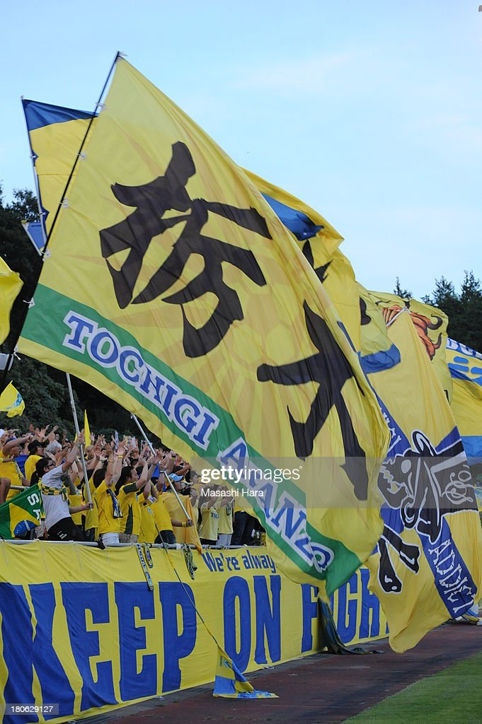 Tochigi SC supporers wave flags before the J.League second division match between Tochigi SC and Consadole Sapporo at Tochigi Green Stadium on September 15, 2013 in Utsunomiya, Japan.