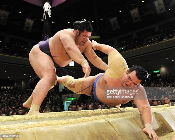 Tochiozan throws ozeki Kotoshogiku to win during day ten of the Grand Sumo New Year Tournament at Ryogoku Kokugikan on January 21 2014 in Tokyo Japan