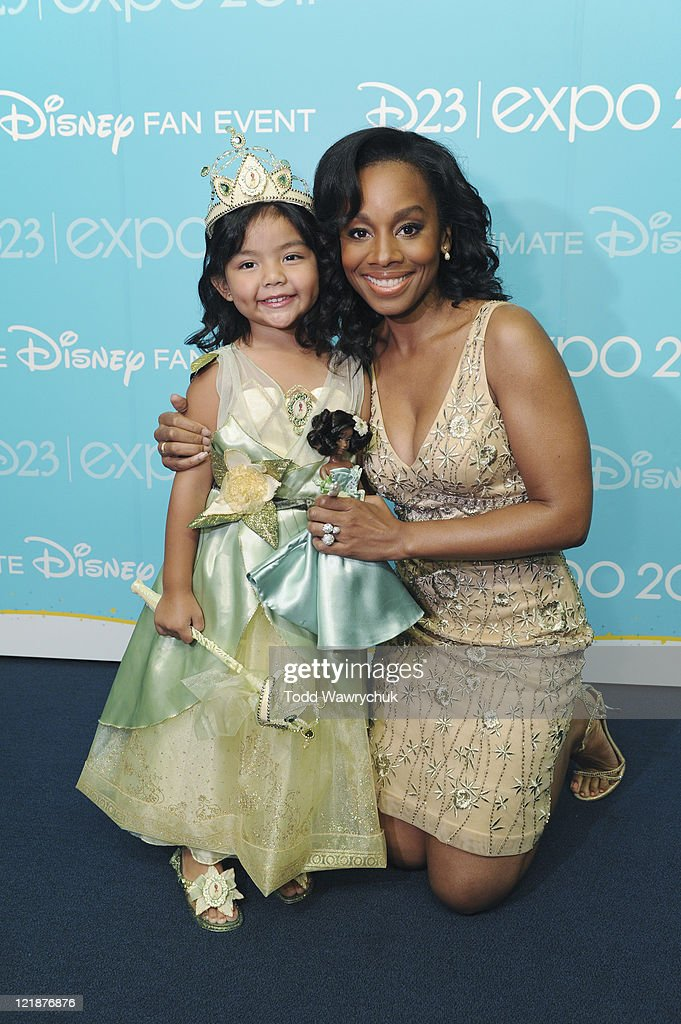 D23 EXPO - AUGUST 19 - Today at the D23 Expo in Anaheim, Calif., Disney Store debuted its Princess Designer Doll collection in a private ceremony prior to the Legends of Disney Awards. The honorees, whose voices brought to life many of the modern-day Disney Princesses, were presented with one of the dolls by a child dressed up as the princess they honored. Honorees included Jodi Benson (Ariel from The Little Mermaid), Paige O'Hara (Belle from Beauty and the Beast), Lea Salonga (singing voices of Jasmine from Aladdin and Mulan from Mulan), Linda Larkin (speaking voice of Jasmine from Aladdin), and Anika Noni Rose (Princess Tiana from The Princess and the Frog). (Photo by Todd Wawrychuk/Disney Channel via Getty Images)RIGHT: ANIKA NONI ROSE
