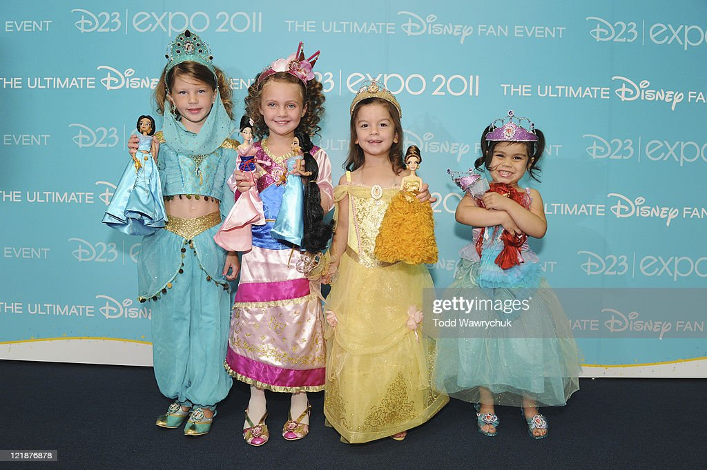 D23 EXPO - AUGUST 19 - Today at the D23 Expo in Anaheim, Calif., Disney Store debuted its Princess Designer Doll collection in a private ceremony prior to the Legends of Disney Awards. The honorees, whose voices brought to life many of the modern-day Disney Princesses, were presented with one of the dolls by a child dressed up as the princess they honored. Honorees included Jodi Benson (Ariel from The Little Mermaid), Paige O'Hara (Belle from Beauty and the Beast), Lea Salonga (singing voices of Jasmine from Aladdin and Mulan from Mulan), Linda Larkin (speaking voice of Jasmine from Aladdin), and Anika Noni Rose (Princess Tiana from The Princess and the Frog). (Photo by Todd Wawrychuk/Disney Channel via Getty Images)FANS