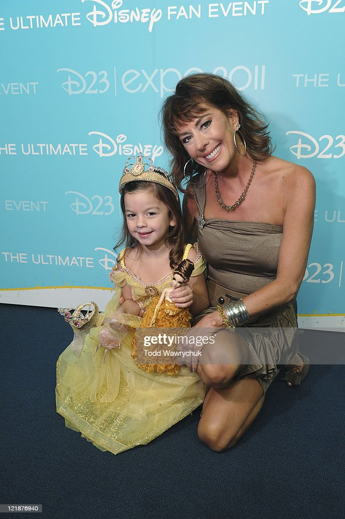 D23 EXPO - AUGUST 19 - Today at the D23 Expo in Anaheim, Calif., Disney Store debuted its Princess Designer Doll collection in a private ceremony prior to the Legends of Disney Awards. The honorees, whose voices brought to life many of the modern-day Disney Princesses, were presented with one of the dolls by a child dressed up as the princess they honored. Honorees included Jodi Benson (Ariel from The Little Mermaid), Paige O'Hara (Belle from Beauty and the Beast), Lea Salonga (singing voices of Jasmine from Aladdin and Mulan from Mulan), Linda Larkin (speaking voice of Jasmine from Aladdin), and Anika Noni Rose (Princess Tiana from The Princess and the Frog). (Photo by Todd Wawrychuk/Disney Channel via Getty Images)RIGHT: PAIGE O