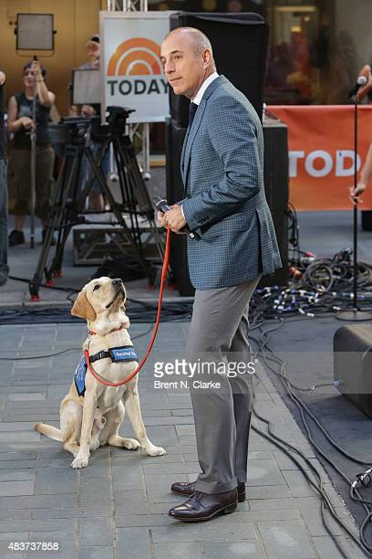 'Today' host Matt Lauer and Wrangler the Dog are seen during recording artist Lunchmoney Lewis's performance on NBC's 'Today' at Rockefeller Plaza on...