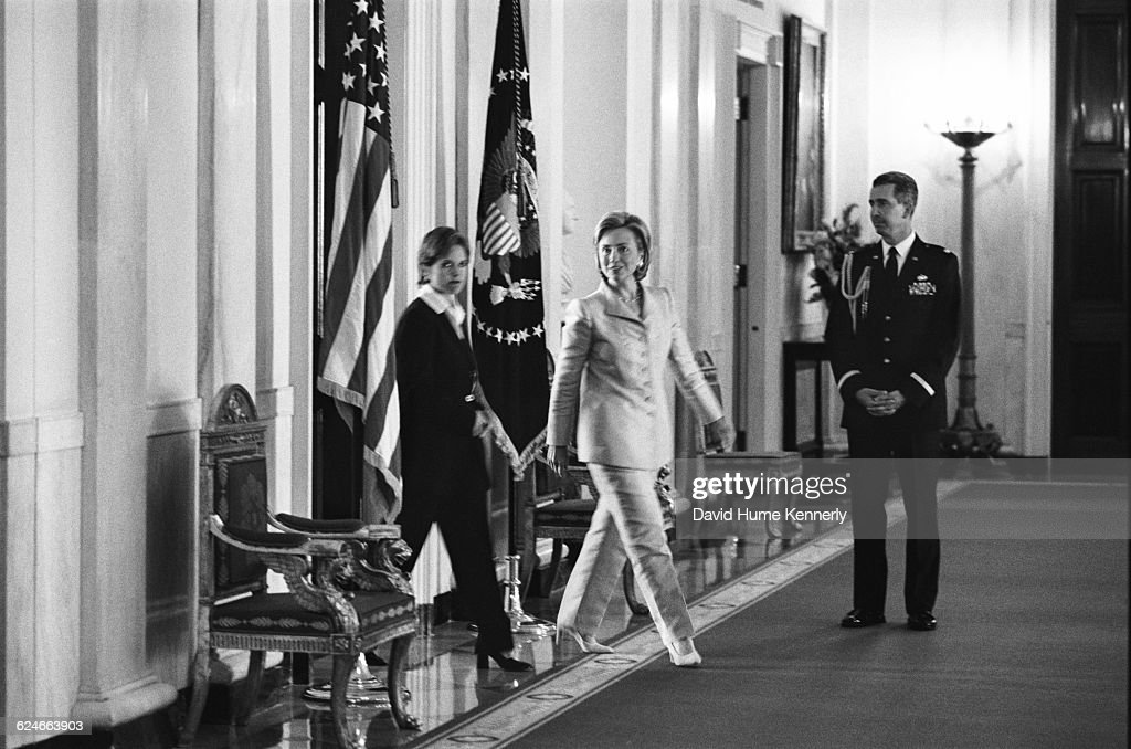 Today Show CoHost Katie Couric and First Lady Hillary Clinton walk to the East Room of the White House for a colon cancer awareness event on...