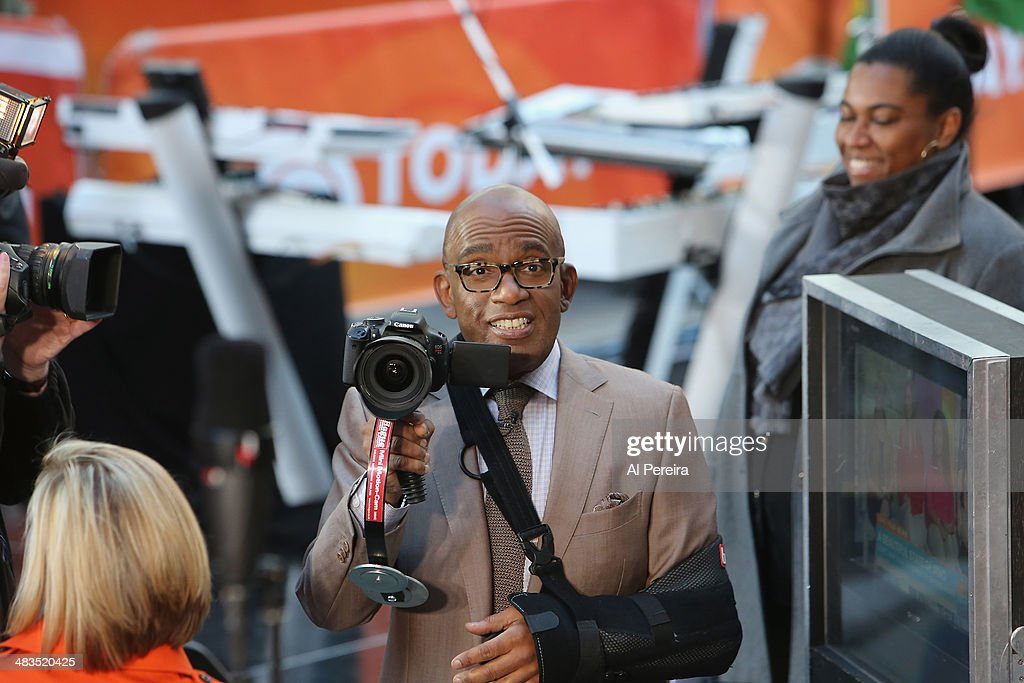 'Today Show' host <a gi-track='captionPersonalityLinkClicked' href=/galleries/search?phrase=Al+Roker&family=editorial&specificpeople=206153 ng-click='$event.stopPropagation()'>Al Roker</a>, arm in a sling, tries out a camera when Janelle Monae performs on NBC's 'Today' at Rockefeller Plaza on April 9, 2014 in New York City.