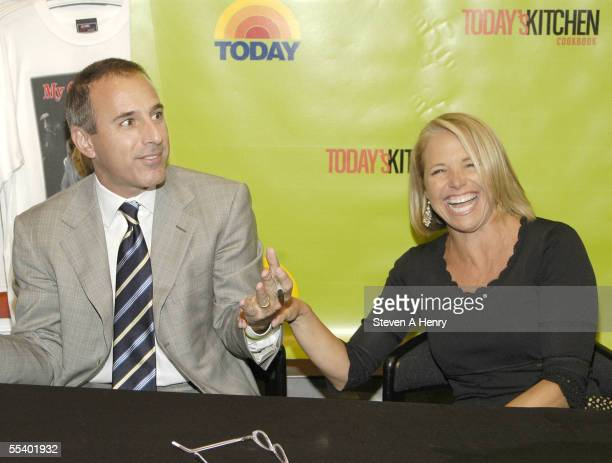 Today Show host Matt Lauer jokes with Katie Couric at the signing of 'Today's Kitchen Cookbook' at the NBC store on September 14 2005 in New York...